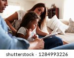 hispanic couple and their young ...   Shutterstock . vector #1284993226