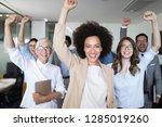 business team celebrating a... | Shutterstock . vector #1285019260