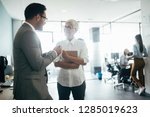 business colleagues in... | Shutterstock . vector #1285019623