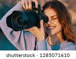 cheerful female photographer in ... | Shutterstock . vector #1285071610