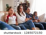 young hispanic family sitting... | Shutterstock . vector #1285072150