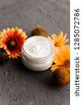 jar of cream and flowers in... | Shutterstock . vector #1285072786