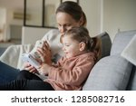 mother and young daughter...   Shutterstock . vector #1285082716