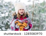 happy caucasian girl in winter... | Shutterstock . vector #1285083970