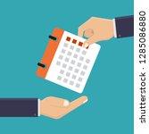 hand holding a calendar ...   Shutterstock .eps vector #1285086880