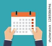 hand holding a calendar ...   Shutterstock .eps vector #1285086946