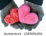 hands wearing woolen gloves... | Shutterstock . vector #1285096306