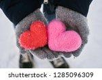 hands wearing woolen gloves... | Shutterstock . vector #1285096309