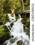 waterfall in a forest with a... | Shutterstock . vector #1285100023