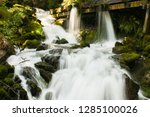 waterfall in a forest with a... | Shutterstock . vector #1285100026