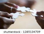 close up hands of african... | Shutterstock . vector #1285134709