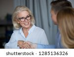 attractive mature businesswoman ... | Shutterstock . vector #1285136326