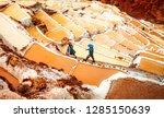 workers at salinas de maras... | Shutterstock . vector #1285150639