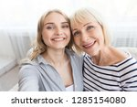 senior mother and daughter... | Shutterstock . vector #1285154080