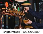 hand of bartender pouring a... | Shutterstock . vector #1285202800