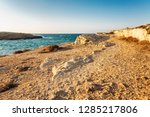 rocky coast  turquoise sea with ... | Shutterstock . vector #1285217806
