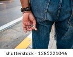 man holding cigarette   Shutterstock . vector #1285221046