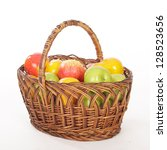apples in basket on a white... | Shutterstock . vector #128523656