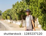 a young man in a sunhat is... | Shutterstock . vector #1285237120