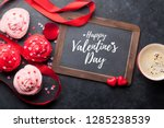 Stock photo valentine s day greeting card with delicious sweet cupcakes and coffee cup on stone background top 1285238539