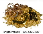 A pile of gold bars, gold jewelry and gold granules. Isolated on white background. Selective focus. - stock photo