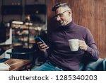unshaven mature man in sweater... | Shutterstock . vector #1285340203