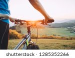 man with bike stay on the top... | Shutterstock . vector #1285352266