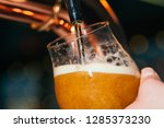 hand of bartender pouring a... | Shutterstock . vector #1285373230