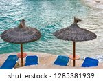 beach with umbrellas and sun... | Shutterstock . vector #1285381939