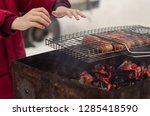 sausages on the grill brazier ... | Shutterstock . vector #1285418590
