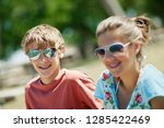 portrait of two smiling... | Shutterstock . vector #1285422469