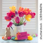 colorful easter egg and tulip... | Shutterstock . vector #1285468696