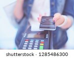 customer is paying with... | Shutterstock . vector #1285486300