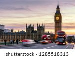 london  the uk. red bus in... | Shutterstock . vector #1285518313