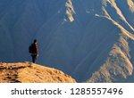 mountaineer traveller at... | Shutterstock . vector #1285557496