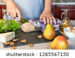 women's hands cut with a knife... | Shutterstock . vector #1285567150