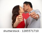 young asian couple in love... | Shutterstock . vector #1285571710