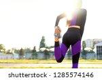 girl sportsman crossfit and... | Shutterstock . vector #1285574146