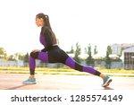 girl sportsman crossfit and... | Shutterstock . vector #1285574149