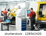 mechanical technicians working... | Shutterstock . vector #128561420