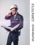 man in helmet and suit trying... | Shutterstock . vector #1285670713