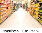 supermarket blur background... | Shutterstock . vector #1285676773