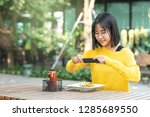 young asian woman food blogger  ... | Shutterstock . vector #1285689550