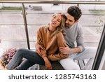 emotional curly woman enjoying... | Shutterstock . vector #1285743163