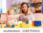 nursery teacher looking after... | Shutterstock . vector #1285752013