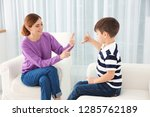 hearing impaired mother and her ... | Shutterstock . vector #1285762189