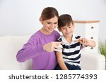 hearing impaired mother and her ... | Shutterstock . vector #1285774393