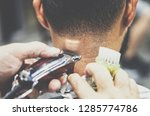 custome receiving new haircut... | Shutterstock . vector #1285774786