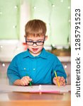 a boy with down syndrome draws... | Shutterstock . vector #1285791523