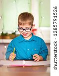 a boy with down syndrome draws... | Shutterstock . vector #1285791526